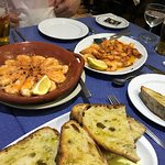 Oven baked prawns with grilled sourdough rubbed with garlic and olive oil.