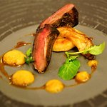 Pan roasted wood pigeon with burnt orange purée, smoked apple, sage fondant potato, watercress