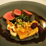 Venison loin with pickled blackberries, artichoke petals, celeriac gratin, kale, Shiraz reductio