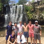 Young men at the waterfall