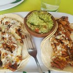Al pastor tacos with cheese and guacamole