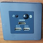 USB charge ports and HDMI for the TV.