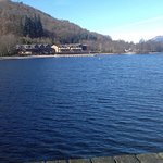 Hotel on left looking up Loch Lomond with Ben in rear covered in snow