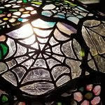 The Tiffany display is mesmerizing, look at the details on this cobweb lamp.