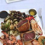 """Beef Wellington surf n turf, """"lime in the coconut"""", mai tai-signature drink."""