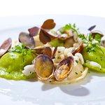"""Home made Ravioli """"paglia e fieno"""" filled with kingfish, calamari and clams."""