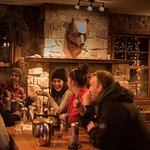 Enjoy a warm meal by the fire after a long day on the slopes