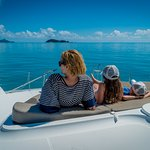 Chilling out on the bow of your bareboat sailing through the Whitsundays
