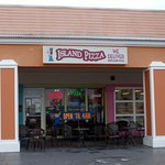 front of & entrance to Island Pizza