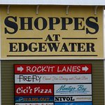 Dee's Hang-out sign on the lower left of the Shoppes at Edgewater sign