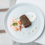 Spice crusted tuna served with coleslaw and curd