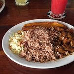 Rice and beans with beef. Includes cole slaw and half plantain.