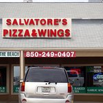front of & entrance to Salvatore's Pizza & Wings