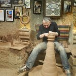 Being shown how make Hittite wine decanter on foot wheel