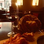 bag of bread with prosciutto and lovely local red wine
