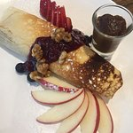Delicious Pancake w/ poached pear, coffee mascarpone, candied walnuts & caramel sauce.