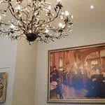 "A Beautiful Chandelier and a beautiful Painting in a Private Section of ""Faubourg""."