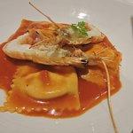 Ravioli alla Veneziana stuffed w ricotta, served w scampi in a cherry tomato white wine sauce