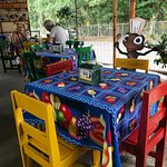 Brightly decorated tables at the front by the road