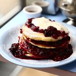 pancake stack with fruits of the forest compote & creme fraiche