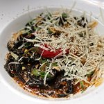 SPAGHETTI NERO squid-ink pasta, calamari confit, white wine sauce, mollica