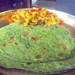 Seasonal round zucchini veggies with Spinach parathas (rotis)