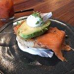 Avocado Toast -- Poached egg, avocado, smoked salmon, toasted brioche and goat cheese,