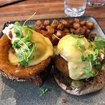 Short Ribs Eggs Benedict with diced roasted potatoes.