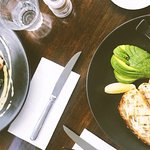 Eggs benedict w/ bacon & vegan breakfast w/ avocado, tomato & hashbrowns