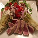Perfectly Done Ahi Tuna added to the wilted caesar salad