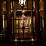 outdoor terrace lit up with christmas tree