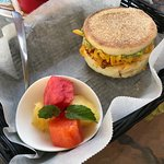 Egg sandwich with fruit and a fruit smoothie