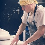 Dough made fresh everyday and rolled by our talented pizza chefs