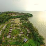 A bird's eye view of Damai Beach Resort as the sun gets ready to set over the horizon