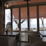 Looking out on the bay on a rainy day. A no draught restaurant thankfully.