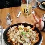Rabbit poutine with 2 mustard sauces