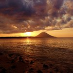 View of Manado Tua from Beach in front of Siladen Resort.