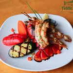 Lobster and Shrimp - Broiled East coast lobster tail and mildly spiced shrimp skewers