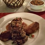 Herb Crusted Pork Loin with Large Fried Plantain and I ordered some Spanish Rice as a side.