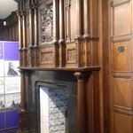 One of the rooms at the house, the panelled walls and fireplace and lots of information and arti