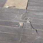 Broken tiles with sharp edges around poolside