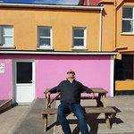 Enjoying the sun at The Coffee House, Castletown-Baera.