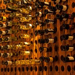 Our wine wall of used bottles