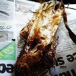 Some calçots, served as tradition dictates, wrapped in newspaper