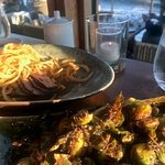 Brussel sproats and ribeye with truffle butter with crispy onions