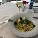 Spaghetti with cheese and oil with a glass of Pinot Grigio