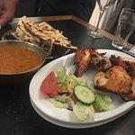 Chicken tikka masala, naan and tandoori chicken dishes as served