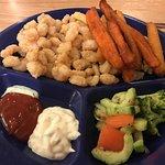 Popcorn shrimp (medium), sweet potato fries, cucumber/tomato salad, broccoli, hushpuppies.