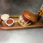 Hatters' Burger: Chargrilled 100% Beef Burger, topped with Crisp Serrano Ham and Smoked Cheese.