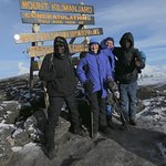 """At the summit with our guides: """"Good Luck"""" and Armani."""
